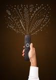 Mão com linhas de controle remoto e encaracolado Imagens de Stock Royalty Free