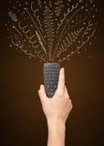 Mão com linhas de controle remoto e encaracolado Foto de Stock Royalty Free