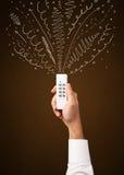Mão com linhas de controle remoto e encaracolado Foto de Stock