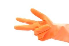 Mão com a luva de borracha alaranjada Imagens de Stock Royalty Free