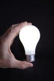 Mão com luz Imagens de Stock Royalty Free