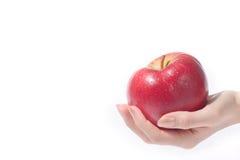 Mão com maçã foto de stock