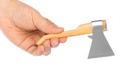 Mão com machado do brinquedo Fotos de Stock Royalty Free