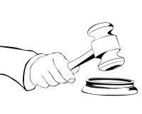 Mão com martelo judicial Fotografia de Stock Royalty Free