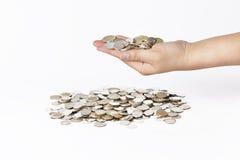 Mão com moeda Fotografia de Stock