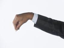 Mão com moeda da moeda Fotos de Stock