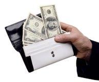 Mão com moeda do dólar Fotografia de Stock