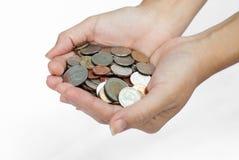 Mão com moedas Imagens de Stock