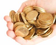 Mão com moedas Fotos de Stock