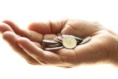 Mão com moedas Fotografia de Stock Royalty Free