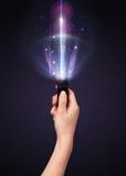 Mão com números do controlo a distância e do brilho Fotografia de Stock