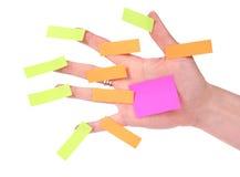 Mão com notas de post-it Imagens de Stock Royalty Free