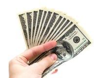 Mão com o dinheiro isolado Fotografia de Stock Royalty Free
