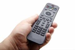 Mão com o dvd de controle remoto Fotografia de Stock