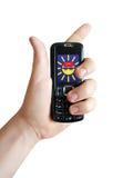 Mão com o telefone de pilha (isolado) Imagens de Stock Royalty Free