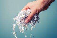 Mão com papel shredded Fotos de Stock Royalty Free