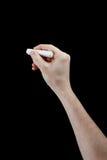 Mão com a parte de giz isolada no preto Fotos de Stock Royalty Free