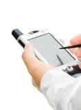 Mão com PDA isolada Fotografia de Stock