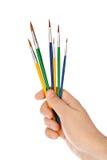 Mão com pincéis coloridos Imagem de Stock