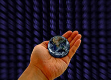 Mão com planeta fotografia de stock