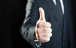 Mão com polegar acima Fotos de Stock Royalty Free