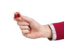 Mão com presente Fotos de Stock