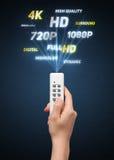 Mão com propriedades do controlo a distância e dos multimédios Foto de Stock Royalty Free