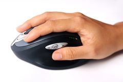 Mão com rato sem fio Imagem de Stock