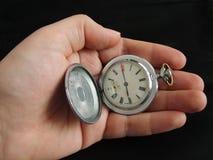 Mão com relógio. Imagens de Stock