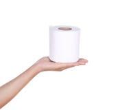 Mão com rolo do papel higiênico imagens de stock royalty free