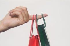 Mão com sacos de compra Imagem de Stock