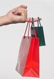 Mão com sacos de compra Imagens de Stock Royalty Free