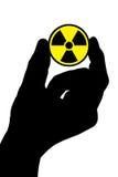 Mão com sinal da radiação Fotografia de Stock