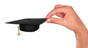 Mão com tampão do estudante Imagens de Stock