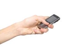 Mão com telefone Imagem de Stock
