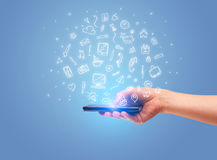 Mão com telefone e ícones tirados do escritório Imagem de Stock Royalty Free