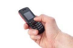 Mão com telefone móvel Foto de Stock Royalty Free