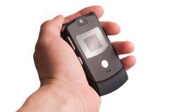 Mão com telefone móvel Imagens de Stock