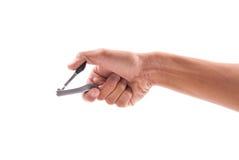 Mão com tosquiadeira de prego fotografia de stock