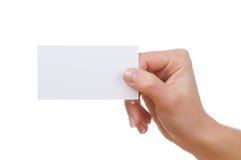 Mão com um cartão Fotografia de Stock
