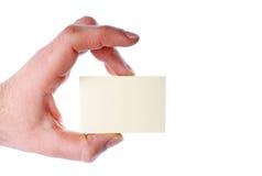 Mão com um cartão Foto de Stock