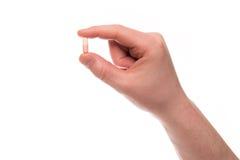 Mão com um comprimido Foto de Stock