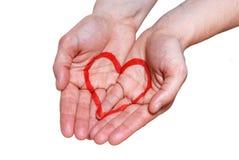 Mão com um coração imagens de stock royalty free