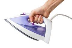 Mão com um ferro elétrico imagem de stock royalty free