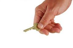 Mão com uma chave Imagem de Stock Royalty Free
