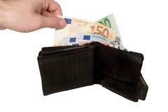 Mão com uma euro- conta Imagens de Stock Royalty Free