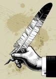 Mão com uma pena Fotografia de Stock Royalty Free