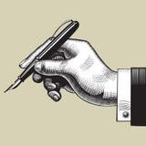 Mão com uma pena Fotografia de Stock