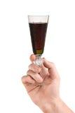 Mão com vidro do vinho vermelho imagens de stock