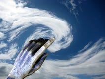 A mão controla os céus. Imagens de Stock Royalty Free